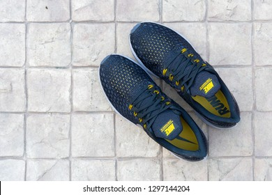 BANGKOK, THAILAND - JANUARY 13,2019 :Nike Air Zoom Pegasus 35 Men's Running Shoes BLACK/MTLC PEWTER color  on tile floor outdoor. Nike is a global sports clothes and running shoes retailer