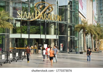 Bangkok, Thailand - January 14, 2014: Shoppers visit Siam Paragon mall in the Siam Square area. With 300,000 sq m of retail space Siam Paragon is one of the world's largest shopping malls.