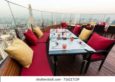 BANGKOK, THAILAND, JANUARY 14, 2015 : Restaurant table with view on the Baiyoke tower and the cityscape at the Red Sky Rooftop of the Centara hotel in Bangkok, Thailand.