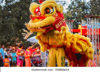 BANGKOK, THAILAND - JANUARY 14 2016: Unidentified group of people perform a traditional lion dance at Rama IX public park to celebrate traditional Chinese's lunar new year