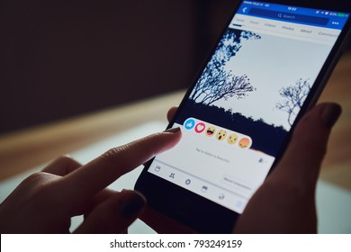Bangkok, Thailand - January 14, 2018 : hand is pressing the Facebook screen on apple iphone6 ,Social media are using for information sharing and networking.