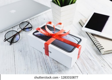 Bangkok, Thailand - january 14, 2019: iphone XR in gift box on table, iphone XR is manufactured by apple inc.