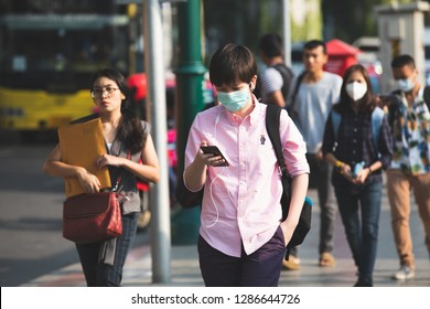 Bangkok, Thailand - January 14, 2019 :Unidentified people wearing mouth mask against air smog pollution with PM 2.5 walking on street at chatuchak district in  Bangkok city, Thailand.