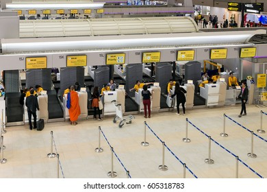 BANGKOK, THAILAND - JANUARY 15, 2016: Nok Air Airline Counter Check-in and baggage drop-off full of ground staff and passengers at Don Mueang International Airport Terminal 2 for domestic flights.