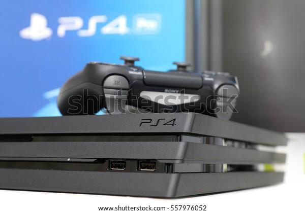 BANGKOK, THAILAND - JANUARY 15, 2017:The New Sony Dualshock Controller with PlayStation 4 Pro on January 15, 2017. in Bangkok Thailand.
