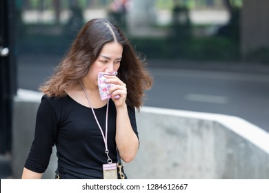 Bangkok, Thailand - January 15, 2019 :Unidentified use the nose cloth instead of the scarce mask for against air smog pollution with PM 2.5 walking on sidewalk in Bangkok city, Thailand.