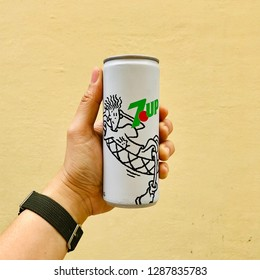 BANGKOK, THAILAND. JANUARY 15 , 2019: The model hand holds the can of soda drink called 7UP which promotes comic called Fido Dido which is popular since 1990s.
