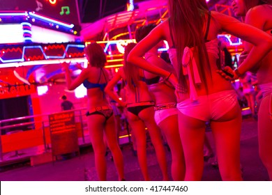 BANGKOK, THAILAND - JANUARY 15: Night rear view of Thai girls in Soi Cowboy street, one of the three red districts of Bangkok. Thailand 2016