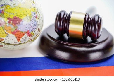 Bangkok, Thailand - January 16, 2019 Russia : Judge hammer on wold globe map. Law and justice court concept.