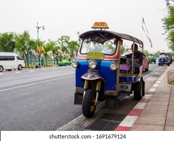 Bangkok, Thailand - January 16, 2020: Traditional Thai tuc tuc taxi near the Grand Palace.