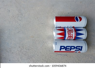 BANGKOK, THAILAND - JANUARY 16,2016 : Cold and icy Pepsi vintage can against on floor. Pepsi is a carbonated soft drink produced by PepsiCo.Copy space image.