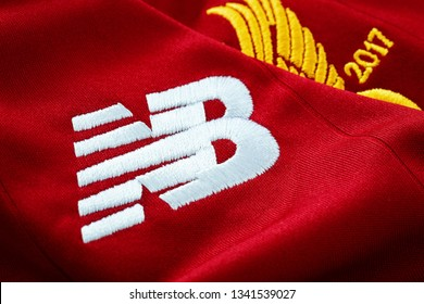 Bangkok, Thailand - January 17 2019: Close-up of New Balance logo on Liverpool FC football home jersey circa 2017-2018 with club's emblem, celebrating 125 years of the club