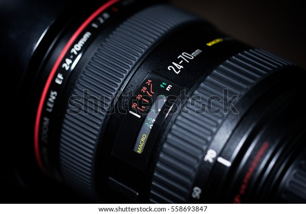 BANGKOK, THAILAND - January 18, 2017: DSLR Camera lens, Canon EF 24-70mm f/2.8L USM on a dark background. Low-key studio shot.