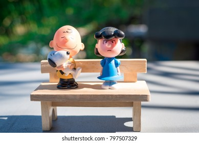 BANGKOK, THAILAND - JANUARY 19, 2018 : Couple Toys From McDonald's Happy Meal With Wooden Benches In My Home , Bangkok Thailand 2018.