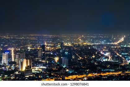 Bangkok, Thailand - January 19, 2019: Skyline view and car light trails from the top of King Power Mahanakhon at night.