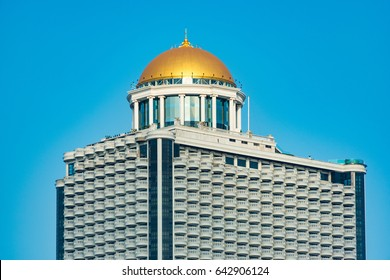 Bangkok, Thailand - January 2, 2016: Golden dome on Lebua state tower against blue sky on the background
