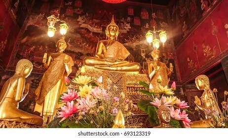 BANGKOK, THAILAND - JANUARY 2: Details of golden buddha statue with tales of the lord Buddha's former births behind at Wat Nairong on January 2, 2017 in Bangkok,Thailand.
