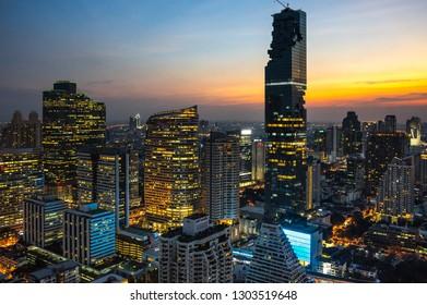 BANGKOK, THAILAND - JANUARY 20, 2017: Top view of skyscrapers in central district of Bangkok on sunset, Bangkok, Thailand