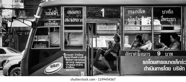 Bangkok, Thailand, January 2018. some people on a bus in the center of the city
