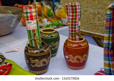"""Bangkok, Thailand - January 21, 2018 : Loincloth and ceramic are the otop products for sale in """"Thailand Tourism Festival 2018"""" at Lumpini Park."""