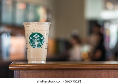 BANGKOK, THAILAND - January 22, 2017:  Starbucks ice cool beverage on table in front of cashier counter