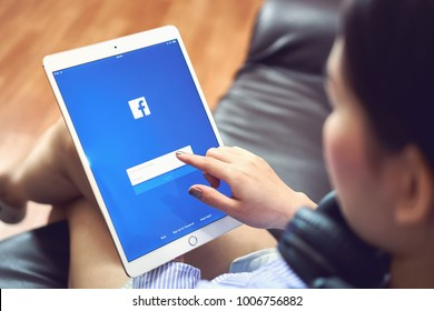 Bangkok, Thailand - January 22, 2018 : hand is pressing the Facebook screen on apple ipad pro,Social media are using for information sharing and networking.