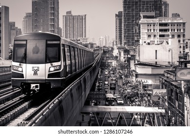 Bangkok, Thailand, January 22 2018 View of the BTS of Bangkok, image of the BTS Station in Black and White, life in Bangkok, people and traffic