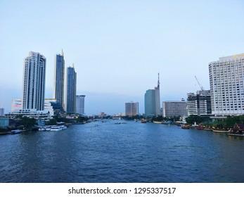 Bangkok, Thailand - January 22 ,2019 : Sapan Taksin bridge, Chao Phraya river of Thailand, Cat telecom building bangrak, ICONSIAM, Bangkok, Shangri-La Hotel Bangkok, Mandarin Oriental, Bangkok.