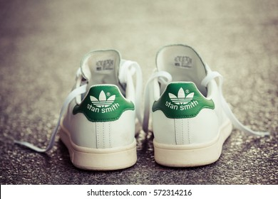 BANGKOK, THAILAND - JANUARY 23, 2017: Adidas stan smith classic shoes on ground stone outdoor popular fashion thailand, process color.