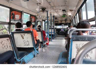 Bangkok, Thailand - January 23, 2018: The inside of a very run-down, worn out public bus in Bangkok, Thailand