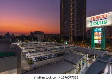 Bangkok, Thailand - JANUARY 23, 2019: Tesco Lotus Sukhumvit 50 (Tesco Lotus Onnut) shot at evening blue hour from BTS Onnut station.