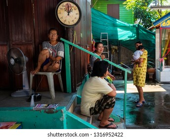 BANGKOK, THAILAND - JANUARY 23, 2019: Women and children in the yard of their home in a poor district