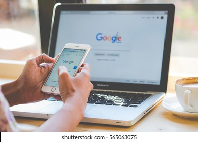 Bangkok. Thailand. January 24, 2016:A woman is typing on Google search engine from a laptop. Google is the biggest Internet search engine in the world.