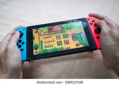 Bangkok, Thailand - January 24, 2018 : Nintendo Switch showing its screen with Stardew Valley game.