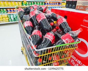 Bangkok, THAILAND, JANUARY 24, 2018: Closeup of Coke bottle in supermarket.Coke bottle on shopping cart for customer purchase.