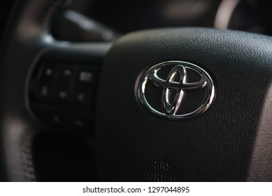 Bangkok Thailand - January 25 2019 :  Toyota Logo on steering wheel in New Toyota Hilux Revo Rocco Pickup Truck Offroad Car brand from Japan based