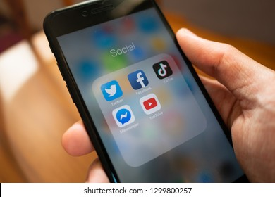 Bangkok, Thailand - January 25, 2019: iPhone 7 showing its screen with Twitter, Facebook, TikTok, Messenger and YouTube application icons.