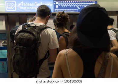 Bangkok, Thailand - January 26, 2018 :  MRT Hua Lamphong railway station public transport. Traveler passenger backpacker buying train ticket. People Foreigner Customers in queue of automatic machine.