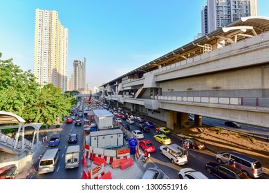 Bangkok, Thailand - January 26, 2019: View of Skytrain Station and Traffic Jam During Rush Hour in Thonburi District