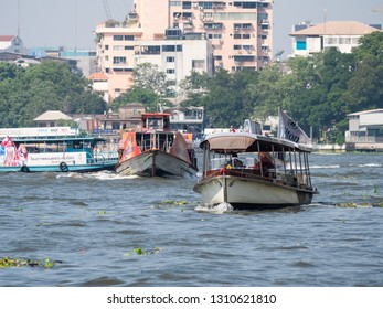 Bangkok, Thailand - January 26, 2019: Small passenger ferries represent an important and popular mode of transport on the Chao Praya River through Bangkok.