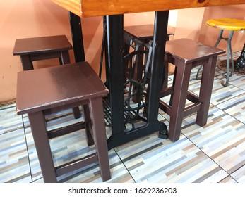 BANGKOK, THAILAND - January 26, 2020 : Table made of Wooden with sewing machine in a restaurant at Bangkok, Thailand.