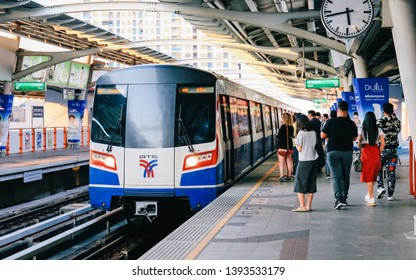 Bangkok, Thailand - January 26,2019 : BTS Skytrain arriving at platform. People using smartphone while waiting for BTS Skytrain. Public transport system in Bangkok city.