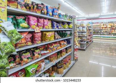 BANGKOK, THAILAND - JANUARY 27, 2018: Snack shelf in 7-Eleven shop interior in Bangkok, Thailand. 7-Eleven is an international chain of convenience stores.