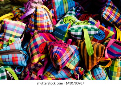 """Bangkok, Thailand - January 27, 2019 : Small bag made from Loincloth are the OTOP products from Amphawa, Samut Songkhram province, for sale in """"Thailand Tourism Festival 2019"""" at Lumpini Park."""