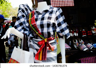 """Bangkok, Thailand - January 27, 2019 : Clothes and shoes made from Loincloth are the OTOP products for sale in """"Thailand Tourism Festival 2019"""" at Lumpini Park."""
