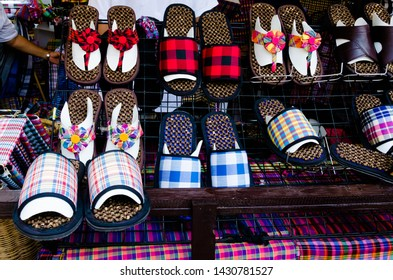 """Bangkok, Thailand - January 27, 2019 : Shoes made from Loincloth are the OTOP products for sale in """"Thailand Tourism Festival 2019"""" at Lumpini Park."""