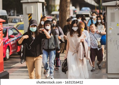 Bangkok, Thailand - January 27, 2020 : Unidentified people  mouth mask against air smog pollution PM 2.5 and Coronavirus walking on street at chatuchak district in  Bangkok city, Thailand.