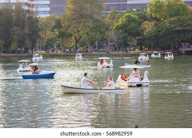 Bangkok Thailand: January 28, 2017:- People relax on a boat in a city park  in Lumpini Park