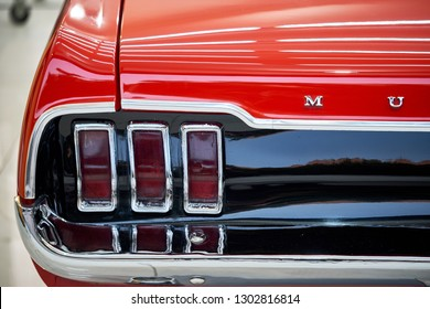 BANGKOK, THAILAND - JANUARY 28, 2019:Ford Mustang taillight with reflection on red paint after paint polishing and coating. Illustration of car detailing and restoration. Vintage American muscle car
