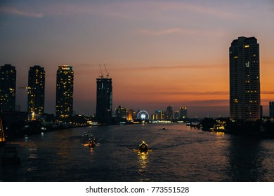Bangkok, Thailand - January 3, 2016: Riverside cityscape at twilght in Bangkok.